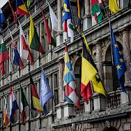 Flags on the parliament buildings in Antwerp, Belgium. Flickr:Leonardo Angelini