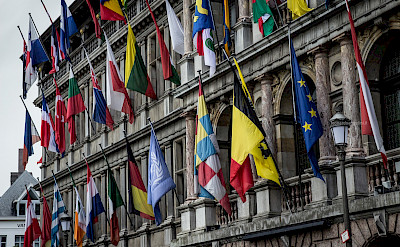 Flags on the parliament buildings in Antwerp, Belgium. Flickr:Leonardo Angelini