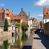 Biking along the canal in Bruges, Belgium. Photo by Regina Losinger