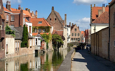 Biking along the canal in Bruges, Belgium. Photo by Regina Losinger