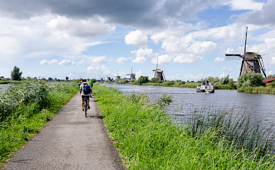 Windmills and bike paths make up Kinderdijk, South Holland, the Netherlands. Photo via Flickr:Luca Casartelli