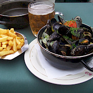 Moules frites (mussels with fries) and beer in Bruges, Belgium. Flickr:Colin Cameron