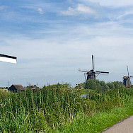 Windmills aplenty on this Amsterdam to Bruges Bike Tour. Photo by Regina Losinger