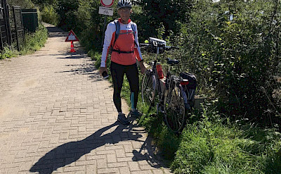 Hennie biking from Rhenen to Wageningen in the Netherlands.