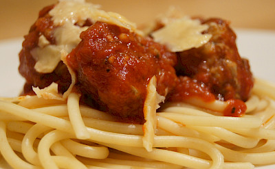 Meatballs and sauce over spaghetti