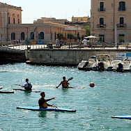 Kayakers in Syracusa, Sicily, Italy. Flickr:Antti Tnissines