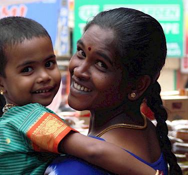 Motherly love in Kerala, India. Flickr:Koen
