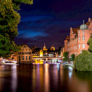 City is aglow at night. Strasbourg, Alsace, France. Flickr:Caroline Alexandre