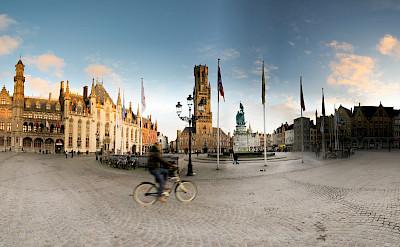 Biking by the Belfry Tower in Bruges, Belgium. Flickr:Panoramas