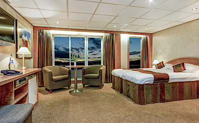 Upper Deck - Suite with French balcony and sofa | Fortuna | Bike & Boat Tours