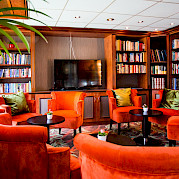 Library on board the Fortuna | Bike & Boat Tours