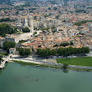 Overlooking Avignon with the Pope's Palace on the Rhône river. Wikimedia Commons:OT Avignon