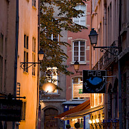 Cafes line the streets in Lyon, France. Photo via TO