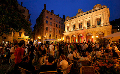 Bustling night in Place du Change, Lyon, France. Photo via TO