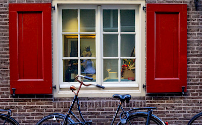 Vermeer painting in the window in Amsterdam, North Holland, the Netherlands. Flickr:Francesca Cappa