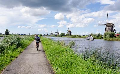 Windmills and bike paths make up Kinderdijk, South Holland, the Netherlands. Photo via Flickr:Luca Casartelli