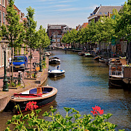 Biking along canals in Leiden, South Holland, the Netherlands. Flickr:Tambako the Jaguar