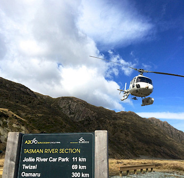 Helicopter ride is included in the New Zealand Alps to Ocean Bike Tour. Photo via TO