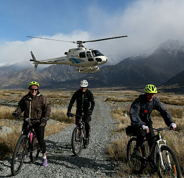 Helicopter ride drop-off to start our adventure on the New Zealand Alps to Ocean Bike Tour. Photo via TO