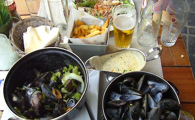 Moules frites with beer in Belgium. Flickr:E and JS Film Crew