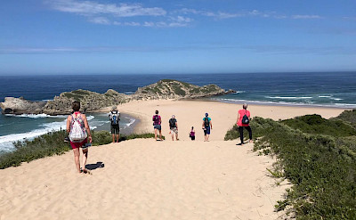 Hennie and group enjoying the beaches on the Garden Route in South Africa.