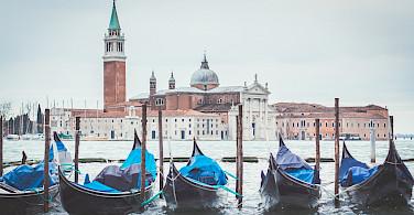 Gondolas await to explore San Marco Square in Venice, Veneto, Italy. Photo via TO