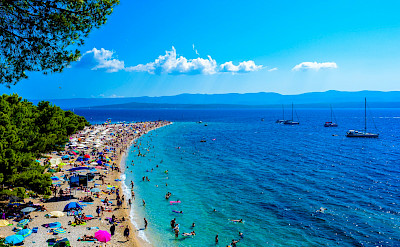Sunbathing on the beach of Brac Island, Croatia. Flickr:Nick Savchenko