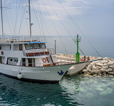 Pape Prvi moored and waiting for you for Bike & Boat Tour in Southern Dalmatia, Croatia.