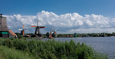 Biking the windmills at the Zaanse Schans, Zaandam, the Netherlands. Flickr:kismihok