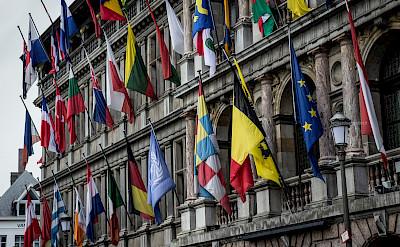 Flags on the parliament buildings in Antwerp, Flanders, Belgium. Flickr:Leonardo Angelini