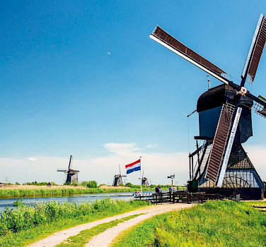 Biking through the Kinderdijk in the Netherlands.