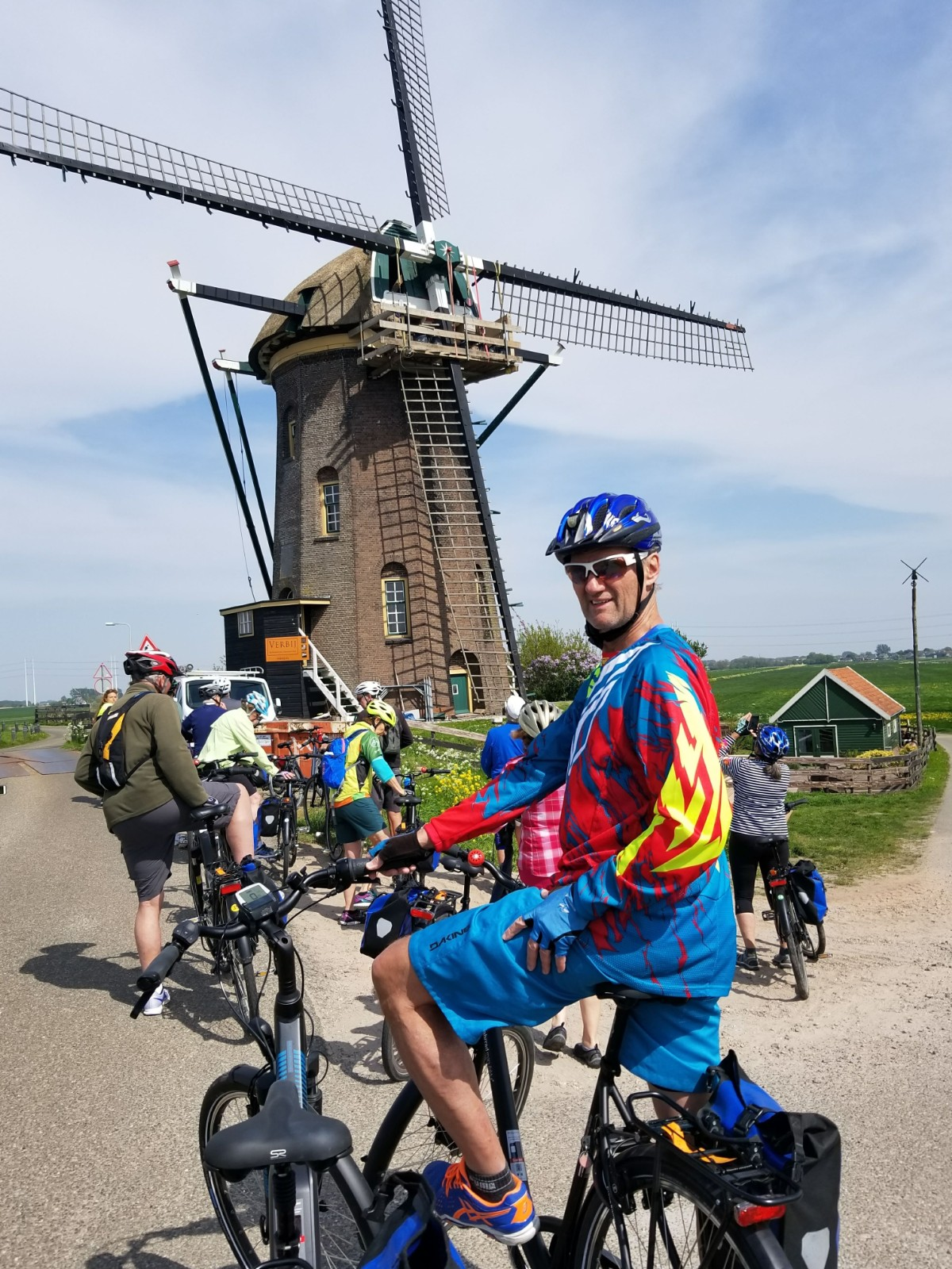 Posing in front of a windmill on our bike tour!