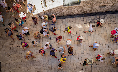 Tourists exploring in Dubrovnik, Croatia. Flickr:Luca Sartoni