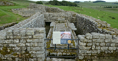 Public latrines at Housesteads Roman Fort along Hadrian's Wall, England. Flickr:Carole Raddato