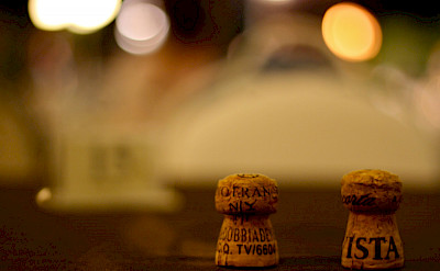 Prosecco corks to end the evening on this Dolomites Hiking Tour in Italy. Flickr:Giacomo Carena