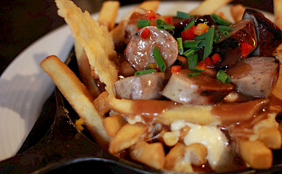Poutine with bratwurst - a Canadian favorite! Flickr:Alyson Hurt