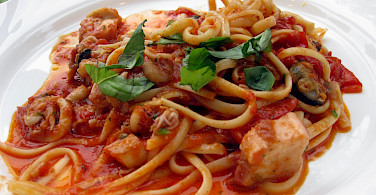 Seafood spaghetti in Sardinia, of course. Flickr:Alex Ranaldi