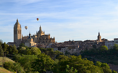 Hot air balloons at the Cathedral in Segovia on the on the Segovia Spain Hike Tour. Photo via TO