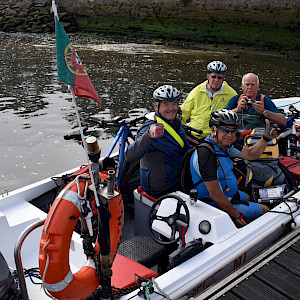 The ferry wasn't running during low tide, so we four riders and our four bikes crammed into this little motor boat to cross from Portugal into Spain.