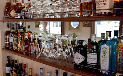 Fully stocked bar on the Aurora | Bike & Boat Tours