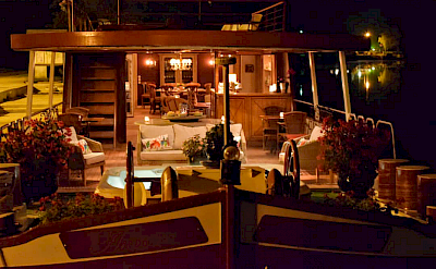 The covered jacuzzi deck on the Aurora | Bike & Boat Tours