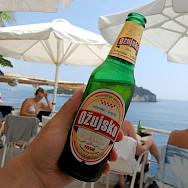 Enjoying a local beer from Cafe Bar Buza in Dubrovnik, Croatia. Flickr:Yusuke Kawasaki