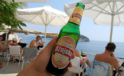 Enjoying a local beer from Cafe Bar Buza in Dubrovnik, Croatia. Flickr:Yusuke Kawasaki