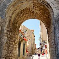 Hiking past the medieval walls in Dubrovnik, Croatia. Flickr:Dennis Jarvis
