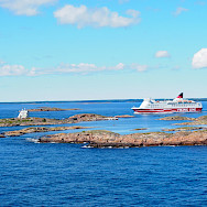 Cycling to the Aland Islands. Cruise ship passing Koppa Klintar near Mariehamn, Finland.