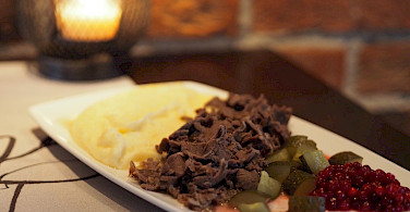 Traditional sauteed reindeer, mashed potatoes and lingon berries in Finland!