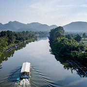 Navigating the River Kwai | Thailand Bike & Boat Tour