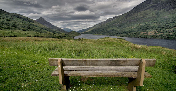 The hiker's bench awaits in Kinlochleven, Scotland Highlands. Flickr:mike138