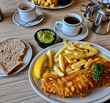 Fish & chips with soda bread in England, of course. Flickr:Mack Lundy