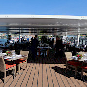Partially covered sun deck on the Alva | Bike & Boat Tours